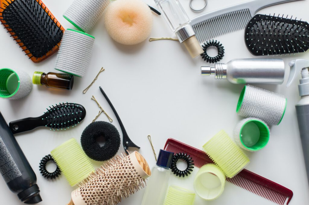 hair brushes, styling sprays, curlers and pins