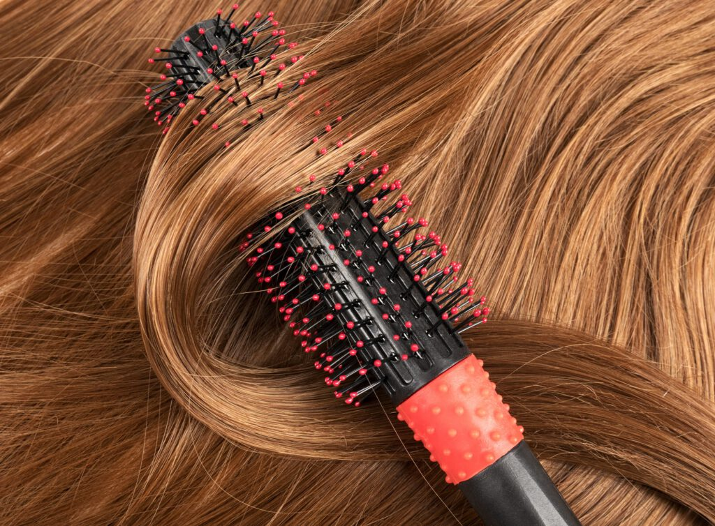 Long red human hair with a comb
